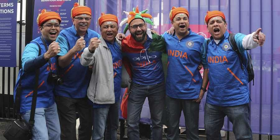 Indian fans cheer for their team before the start of the Cricket World Cup match between India and Pakistan outside Old Trafford in Manchester, England. (Photo | AP)