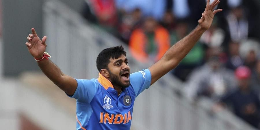 India's Vijay Shankar celebrates the dismissal of Pakistan's Imam-ul-Haq during the Cricket World Cup match between India and Pakistan at Old Trafford in Manchester, England.