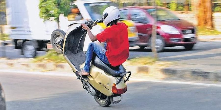 A bike rider wheeling on the busy Ring Road at Hoskere Halli in the city.