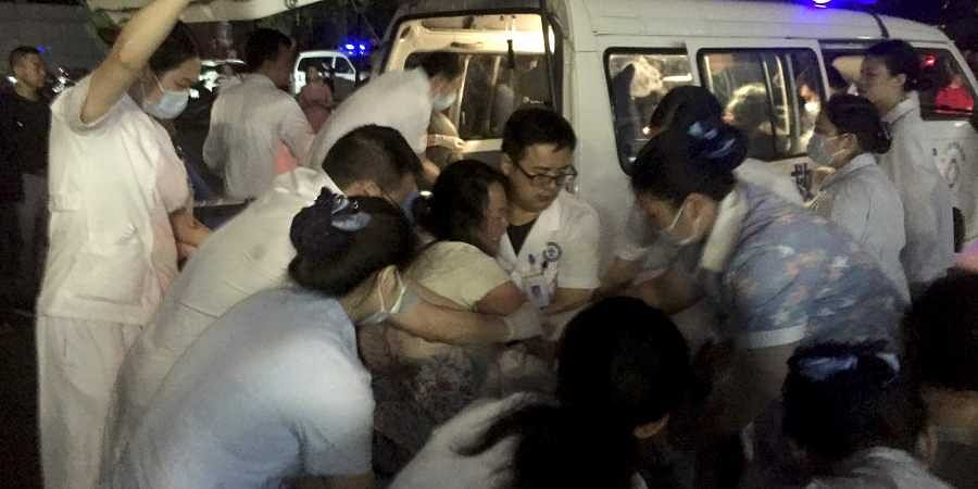 medical staff tend to a wounded at a local hospital in the aftermath of an earthquake in Changning County of Yibin City, southwest China's Sichuan Province, early Tuesday.