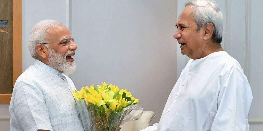 Prime Minister Narendra Modi shakes hands with Odisha Chief Minister Naveen Patnaik during a call on in New Delhi Tuesday June 11 2019.