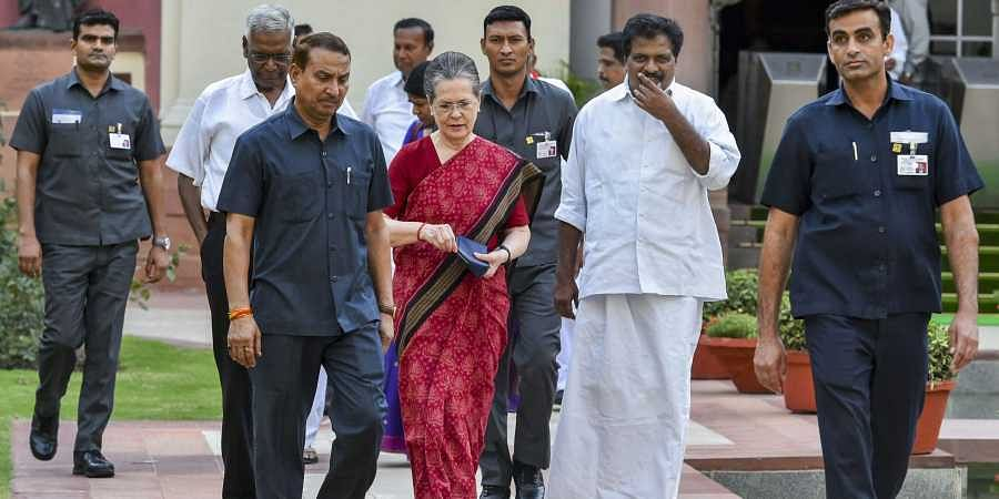 UPA chairperson Sonia Gandhi along with CPI's D Raja and other leaders arrives for a meeting to decide their strategy in Parliament in New Delhi on 18 June 2019. (Photo | PTI)