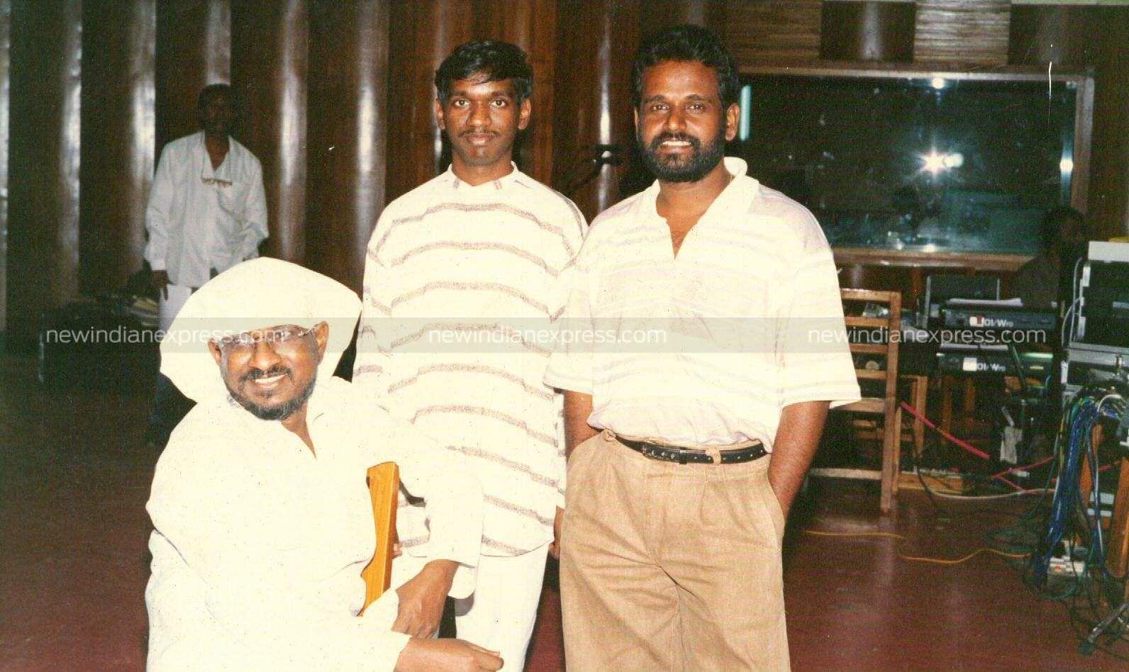 Music director Karthikraja (C), with his father Ilayaraaja (L) at the recording studio.