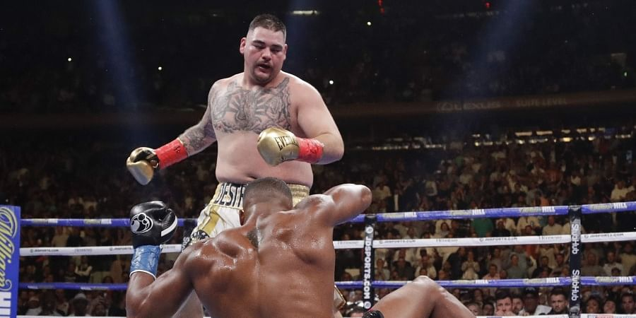 Andy Ruiz knocks down Anthony Joshua during the third round of a heavyweight title boxing match in New York.