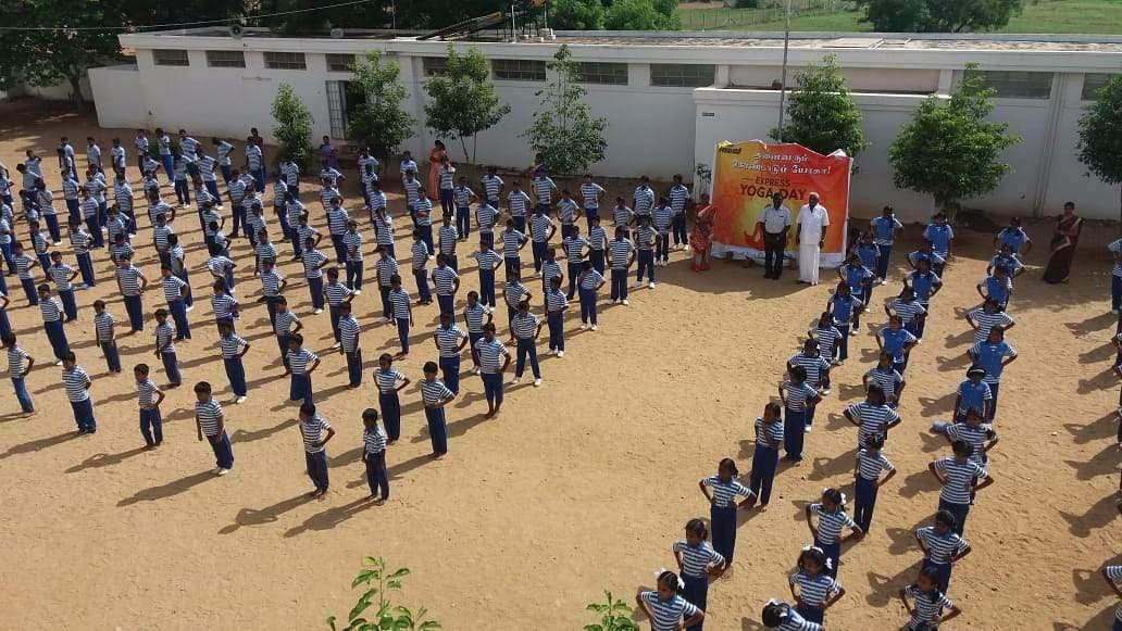 Around 500 people participate in performing an Yogasana at  Jayanthi School in Arulpuram near Tiruppur