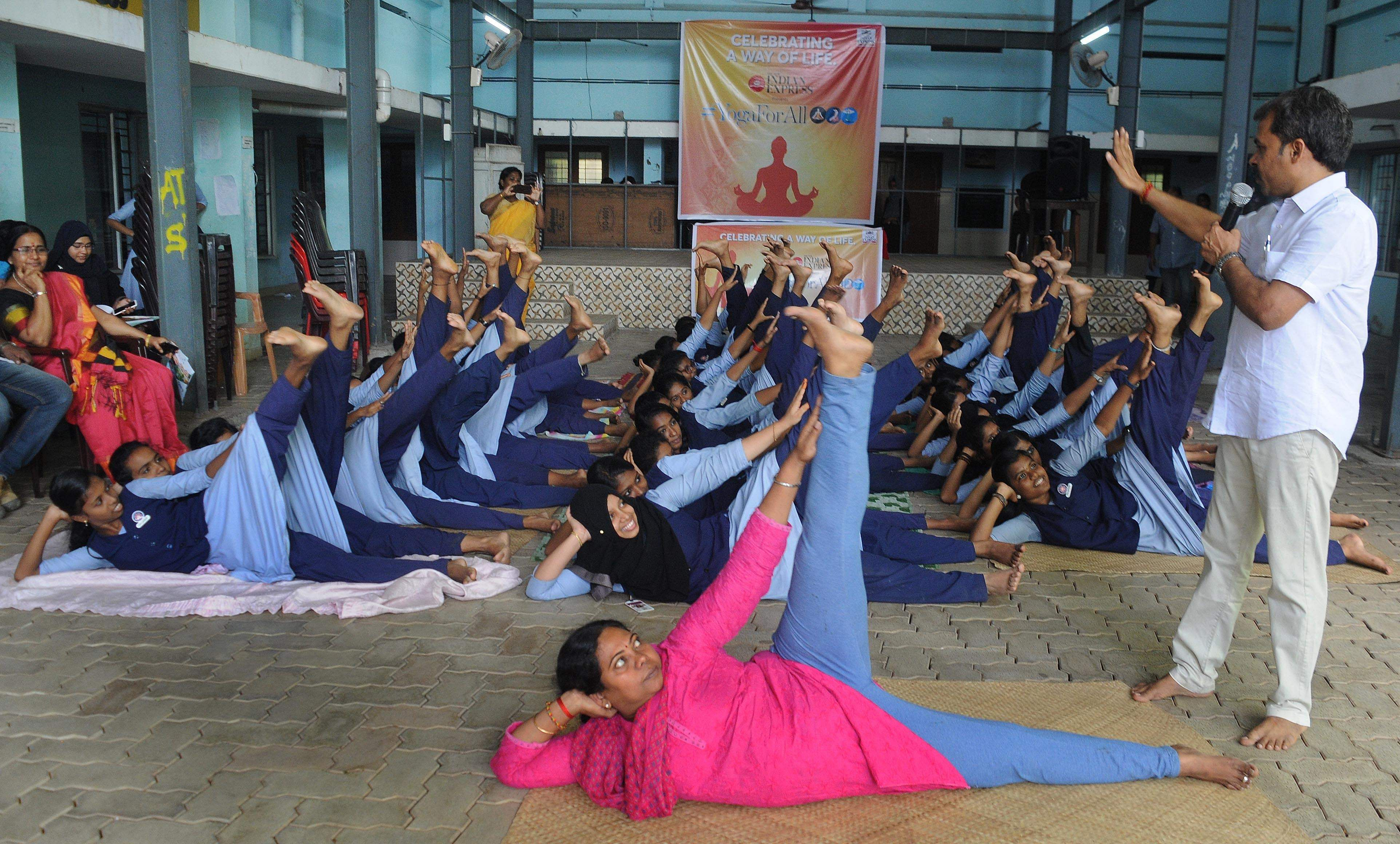 'Yoga for all', an Express initiative to spread awareness on yoga, was held at St Joachim's High School, Kathrikadavu on Tuesday. S Ayyappan, yoga master, instructs the students and teacher during the yoga session. in Kochi