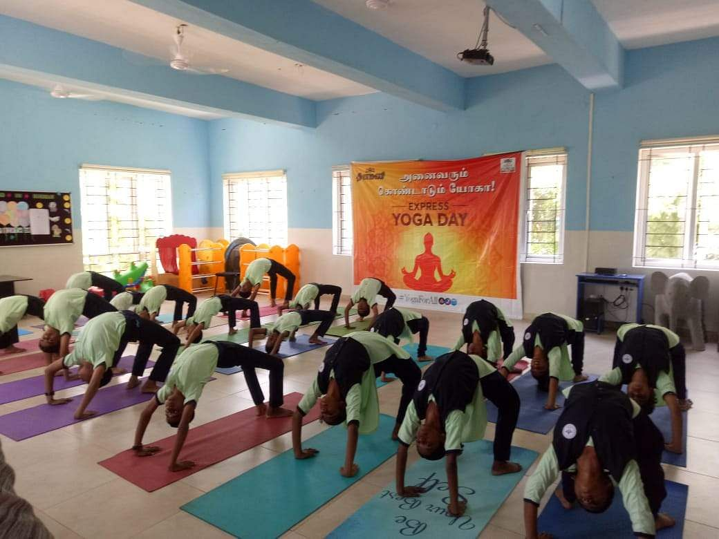 Around 100 people at Mount Litra Zee School in Tiruppur perform yoga ahead of the International Yoga Day