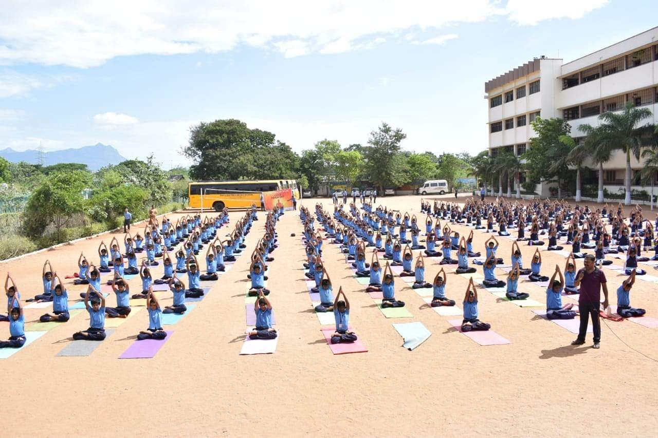 Around 300 members SBOA Matriculation School in Coimbatore practice yoga ahead of the International Yoga Day