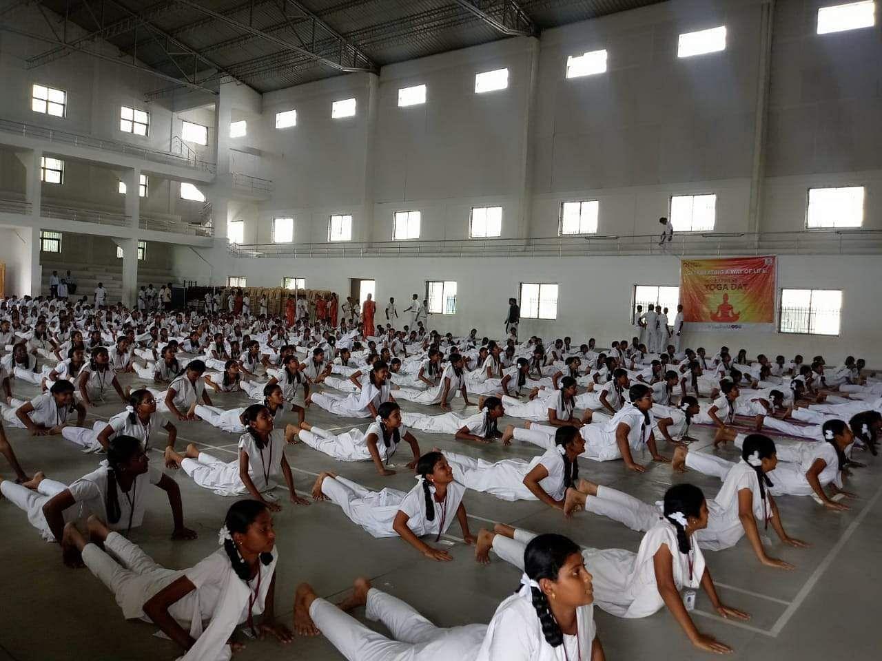 Around 400 members Vijayalakshmi Matriculation School in Sirumugai near Coimbatore perform an yogasana