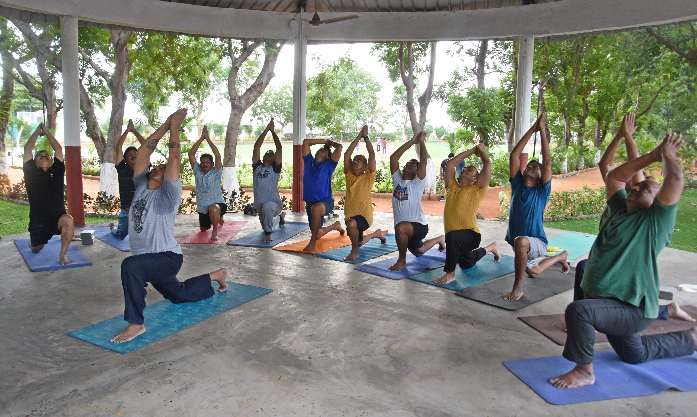 Members of Vijayawada club performing yogasanas at club premises near Vijayawada on Wednesday
