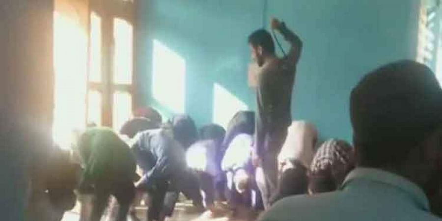 The video shows a Jammu and Kashmir teacher assaulting students for being late by 10 minutes for the class.