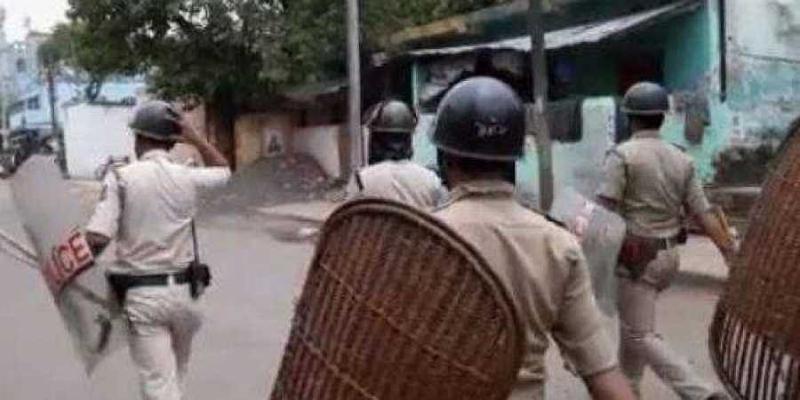 Rapid Action Force (RAF) personnel control the situation in Bhatpara