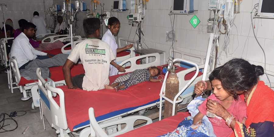 Children showing symptoms of Acute Encephalitis Syndrome AES being treated at a hospital in Muzaffarpur. (Photo | PTI)