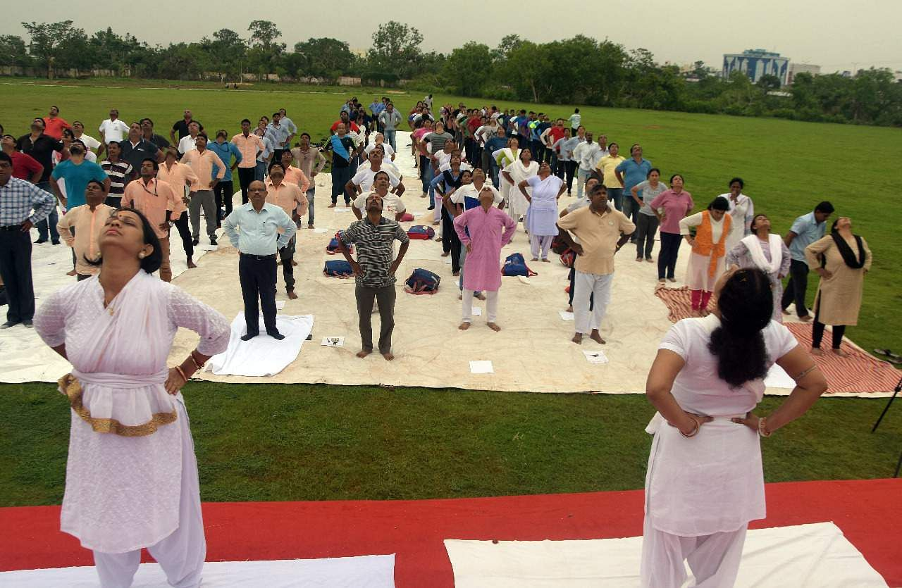 International Yoga Day observed at Utkal University organised by The New Indian Express in Bhubaneswar on Friday