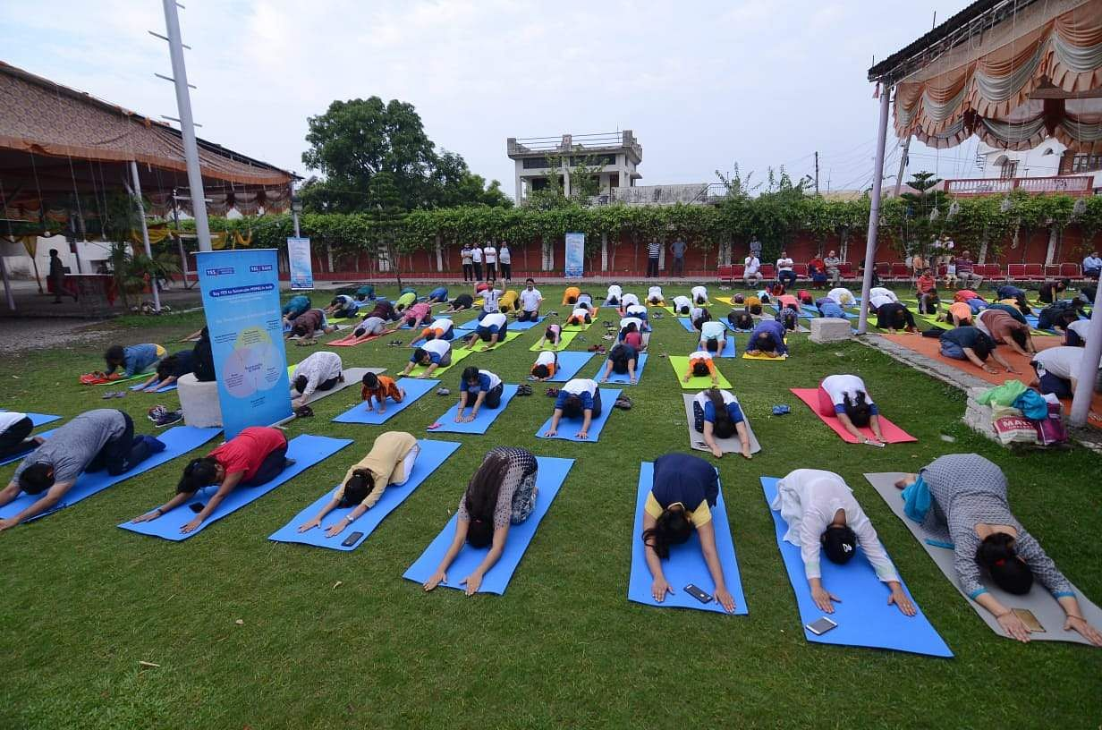 Students of Army Public school Golconda performing yoga organised by TNIE on the mark of Yoga day in Hyderabad on Friday
