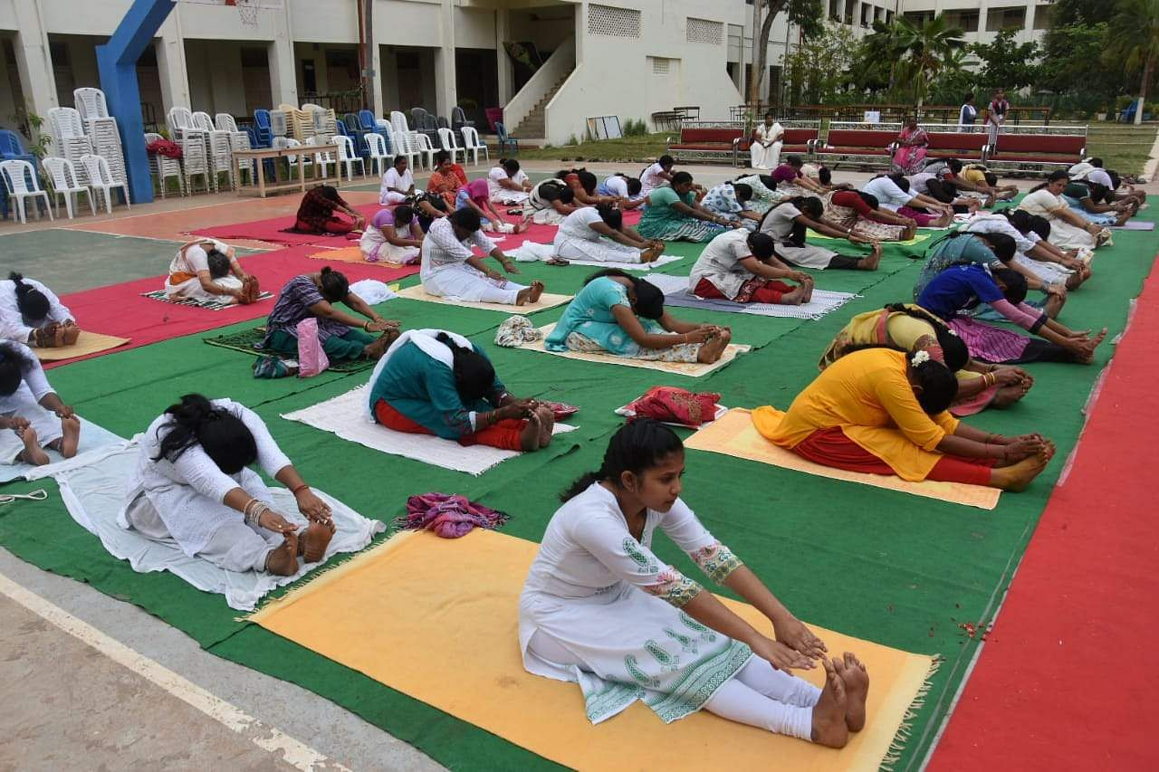 Public participated in yoga at KBN college in association with TNIE in Vijayawada