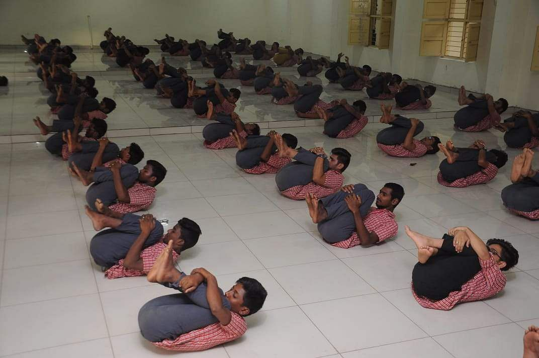 Students performing Yoga on the occasion of International Yoga Day in association with The New Indian Express at Loyola college in Vijayawada on Friday