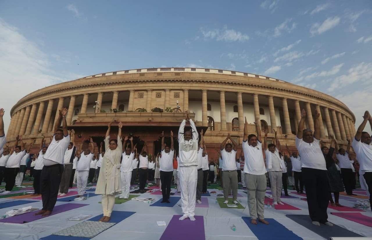 Lok Sabha Speaker Om Birla take part in a mass yoga session on International Yoga Day at Parliament house in New Delhi on Friday