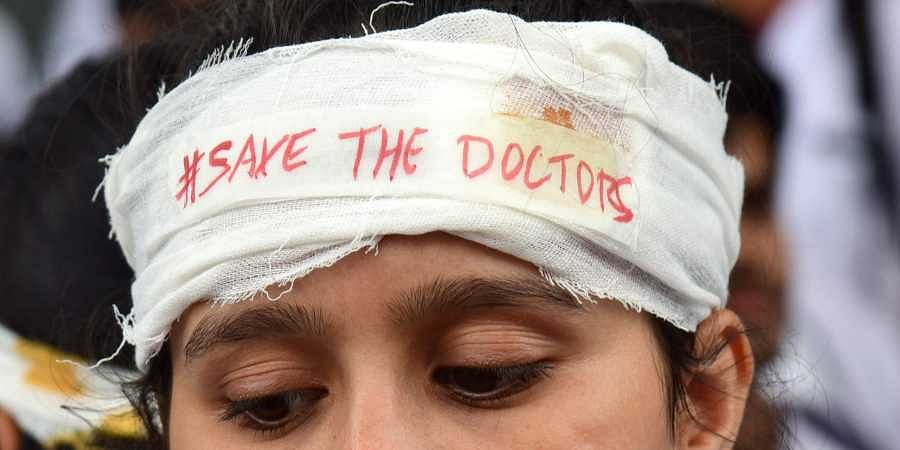 A student protests the attack on doctors in Kolkata.