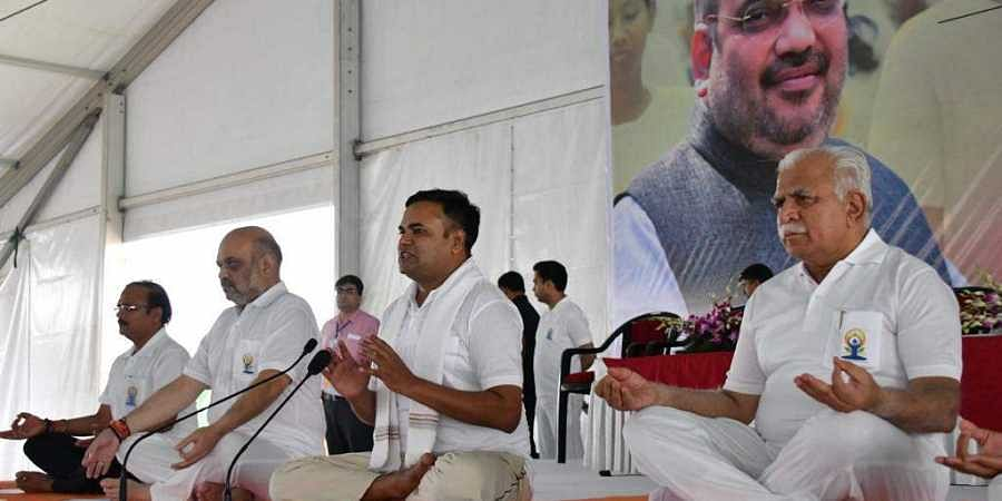 Union Minister Amit Shah and Haryana CM Manohar Lal Khattar at a Yoga day event in Rohtak.