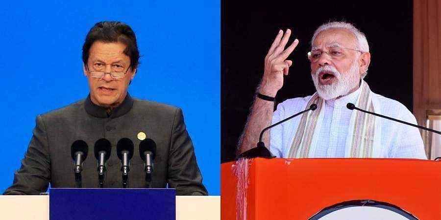 India PM Narendra Modi (R) and his Pakistan counterpart Imran Khan