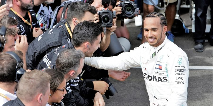 Mercedes driver Lewis Hamilton of Britain celebrates with his team after winning the French Formula One Grand Prix at the Paul Ricard racetrack in Le Castellet.