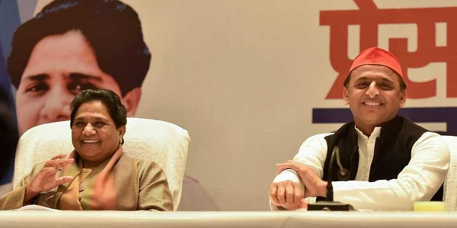 BSP supremo Mayawati and Samajwadi Party chief Akhilesh Yadav during a joint press conference in Lucknow. (Photo | File, PTI)