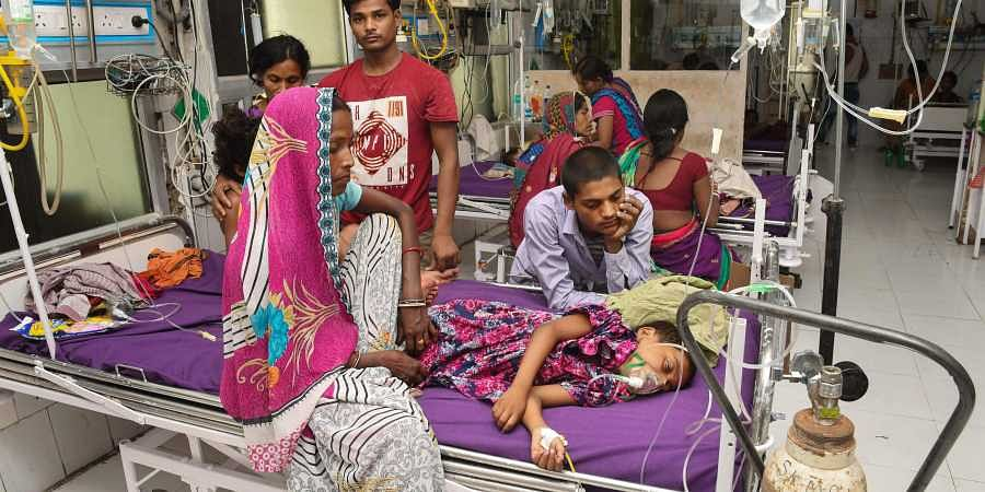 Children showing symptoms of Acute Encephalitis Syndrome being treated at Shri Krishna Medical College and hospital in Muzaffarpur on 16 June 2019. (Photo | PTI)