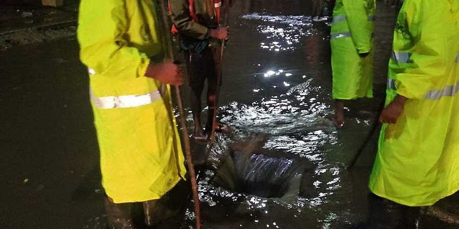GHMC's Disaster Relief Force opening a manhole to allow rainwater to flow on Tuesday