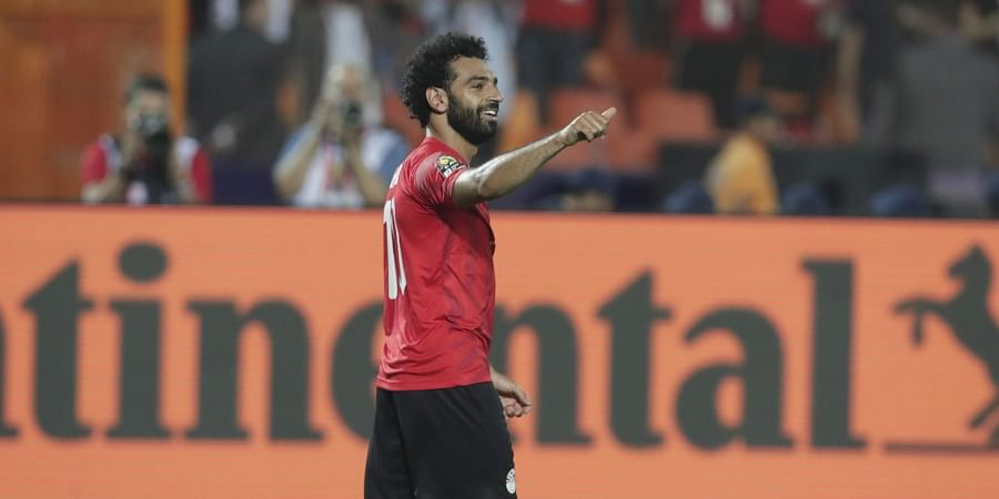Egypt's Mohamed Salah celebrates after he scored during the match between Egypt and DR Congo at the Africa Cup of Nations.