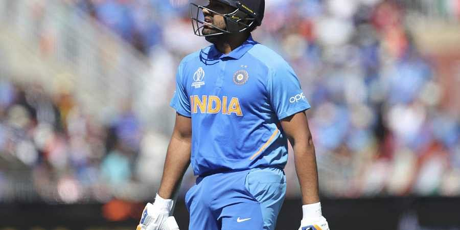 Rohit Sharma walks off the ground after the controversial decision. (Photo | AP)