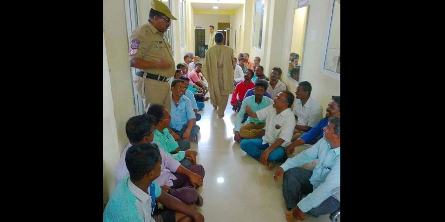 Power loom workers sit-in Sircilla police station demanding release of arrested union leaders in Sircilla.