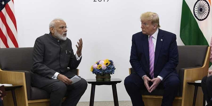 US President Donald Trump meets with Indian Prime Minister Narendra Modi during a meeting on the sidelines of the G-20 summit in Osaka, Japan, Friday, June 28, 2019.