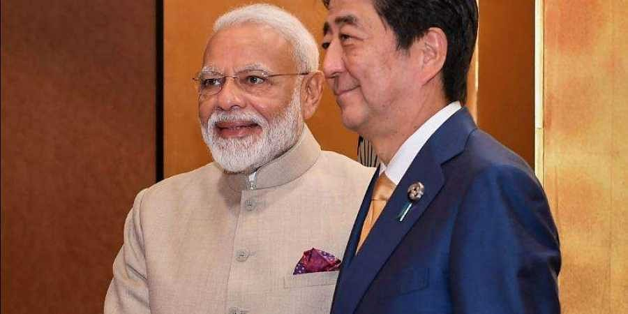 Prime Minister Narendra Modi shakes hands with his Japanese counterpart Shinzo Abe prior to their meeting in Osaka
