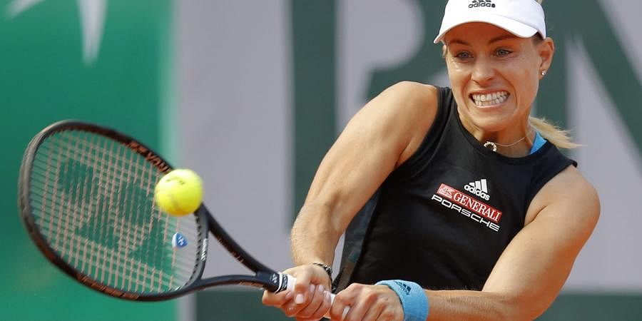 Germany's Angelique Kerber plays a shot against Russia's Anastasia Potapova during their first round match of the French Open tennis tournament at the Roland Garros stadium in Paris. (Photo | AP)