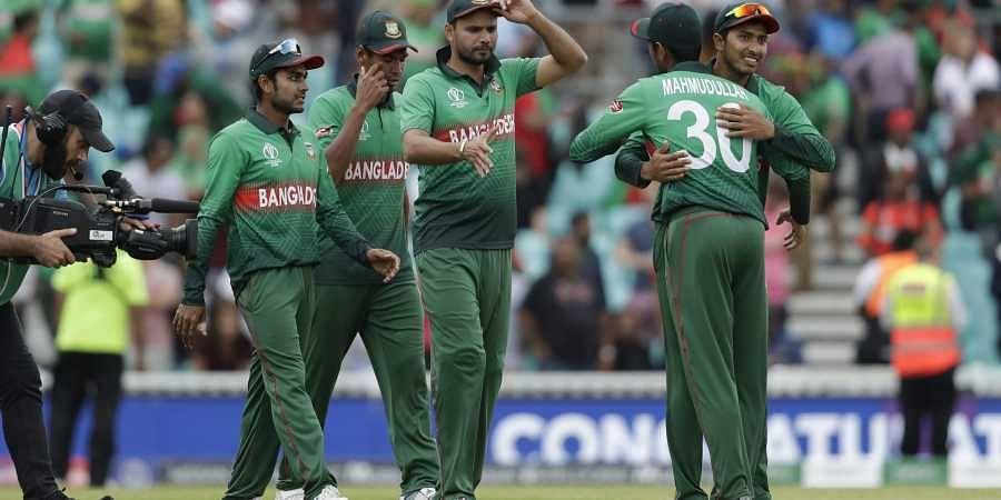 Bangladesh's captain Mashrafe Mortaza, centre, celebrates with his teammates.| AP