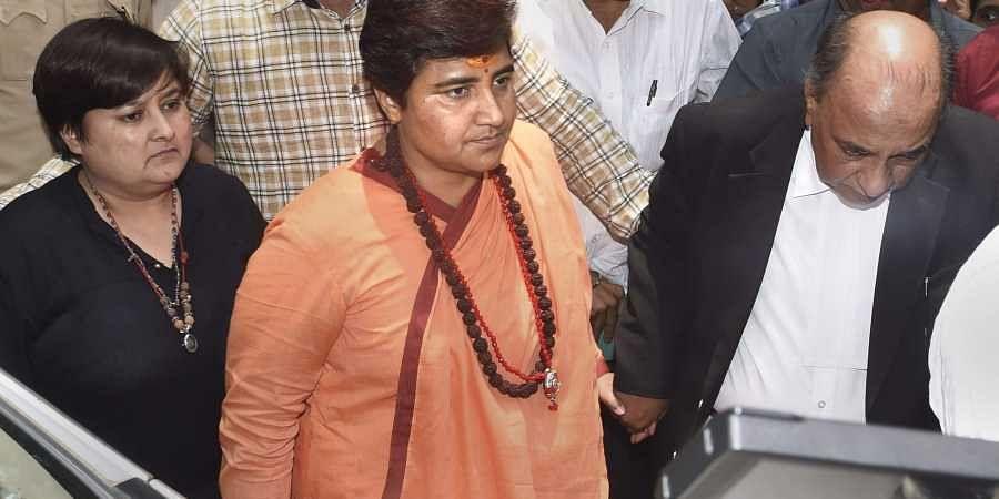Sadhvi Pragya Singh Thakur arrives at a sessions court for a hearing in the 2008 Malegaon blast case in Mumbai on 7 June 2019. (Photo   PTI)