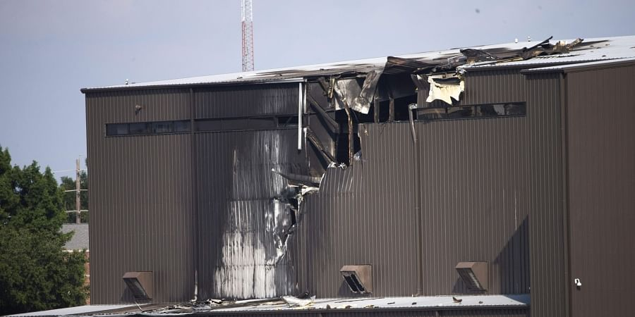Damage is seen to a hangar after a twin-engine plane crashed into the building at Addison Airport in Addison, Texas. (Photo | AP)