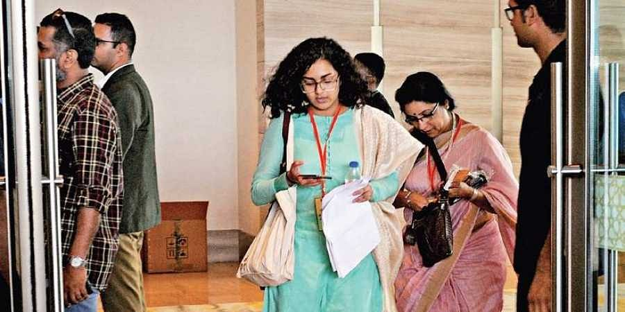 Actors Parvathy Thiruvoth and Revathy leave the venue of AMMA general body meeting in Kochi.