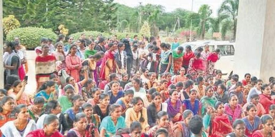 Students of Acharya Nagarjuna University stage protest for clean water, other basic amenities.