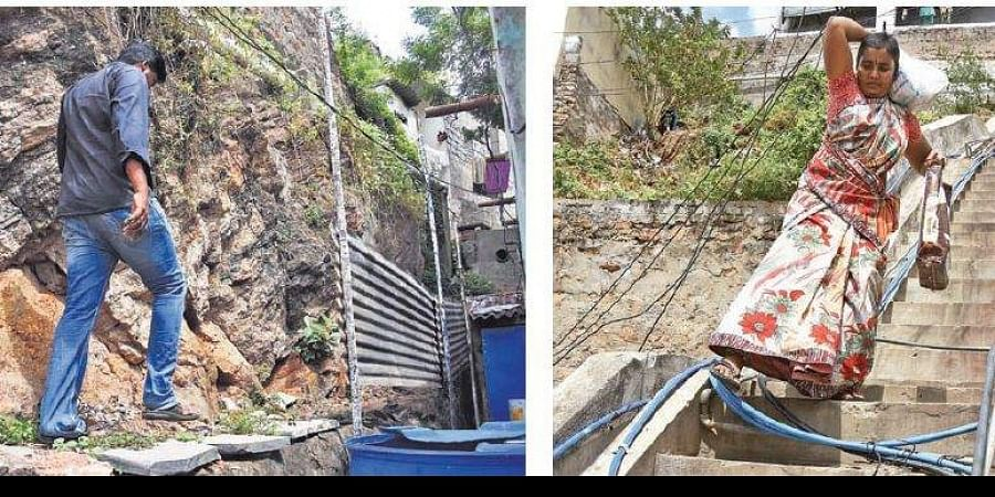 A man walks on a narrow path to the hillock colony at Moghalrajpuram in Vijayawada; these haphazard pipes could prove death trap for residents.