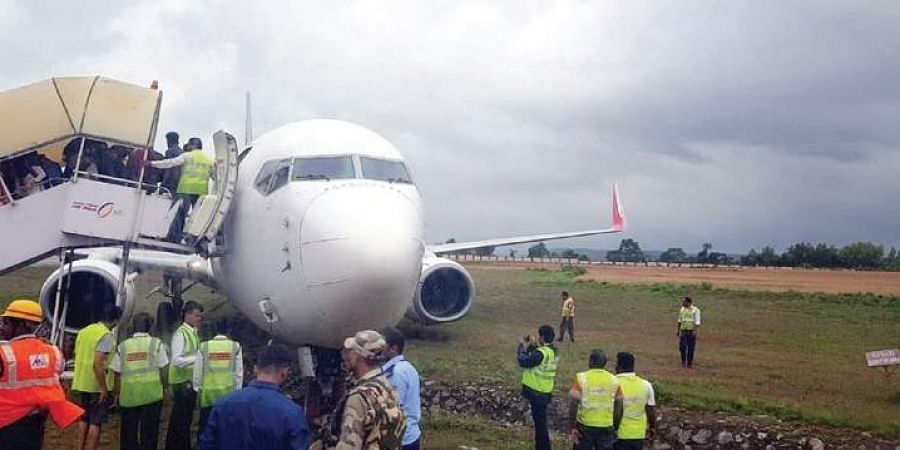 Passengers being evacuated from AI Express flight at Mangalore International Airport.