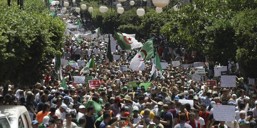 Algerian demonstrators take to the streets in the capital Algiers to protest against the government