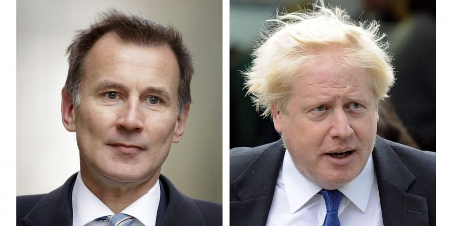 In this two photo file combo image, Jeremy Hunt, left, and Boris Johnson, right, who are the final two contenders for leadership of the Conservative Party, Thursday June 20, 2019.
