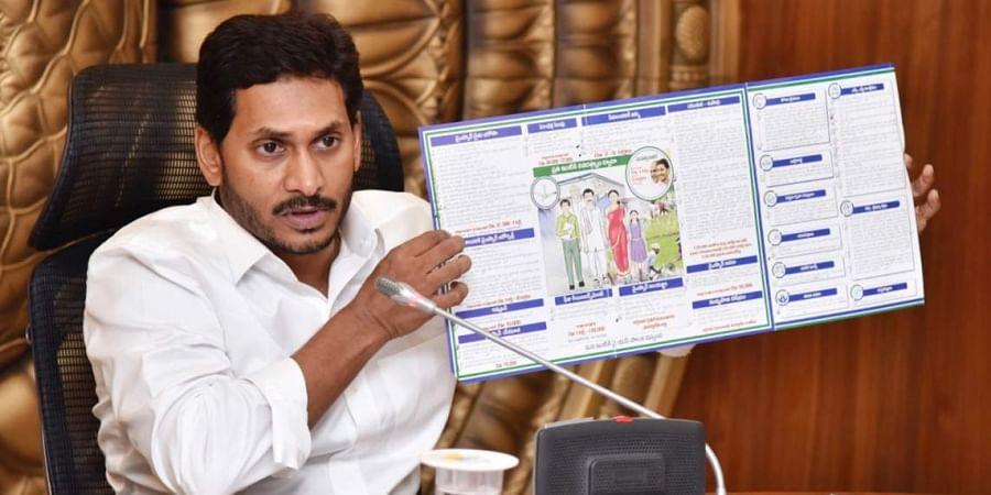 Andhra Pradesh CM YS Jagan Mohan Reddy with YSRC manifesto during cabinet meeting at Secretariat in Velagapudi.