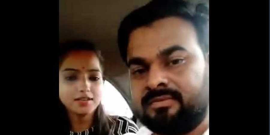 BJP's Bareilly MLA Rajesh Mishra's daughter with her alleged husband Ajitesh. (Video screengrab)