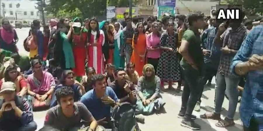 Students of University College protested outside the college after a 3rd year student got stabbed in a clash that broke out between the members of SFI and other students of the college, today.