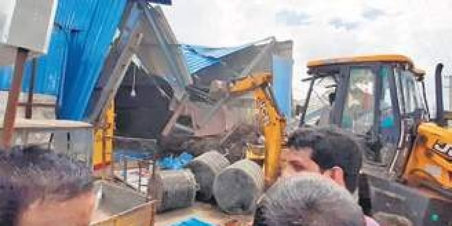 Illegal structures removed by GHMC at Ziaguda on Monday.