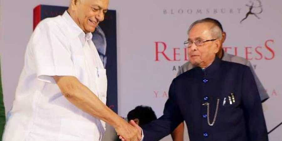 Former PresidentPranab Mukherjee (R) and former Union Finance Minister Yashwant Sinha