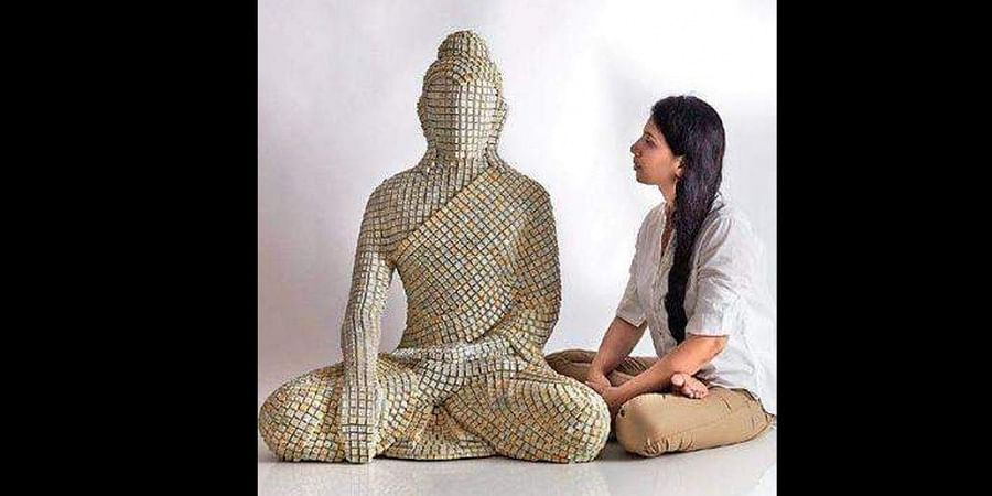 Sangeeta Abhay with her sculpture that will be on display at the fest.